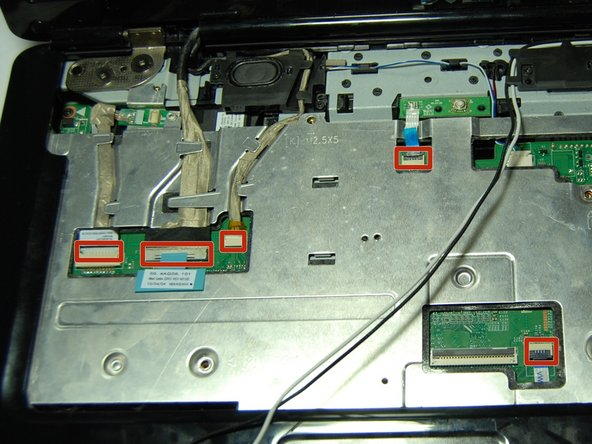 Disconnect the Bluetooth card cable, Wed cable, Camera1 cable, power cable, and touchpad cable from the respective Motherboard connectors as marked. For the Bluetooth cable and Camera1 cable, pull the plugs towards the screen. For the touchpad and power cable, lift the black tab and then pull them out. For the Wed cable, pull the blue tab up.
