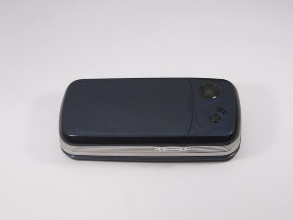 Flip phone over so screen side is now facing down.