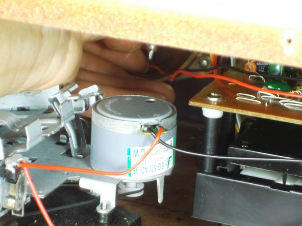 Carefully pull the wires out of their connections from the back of the speaker.