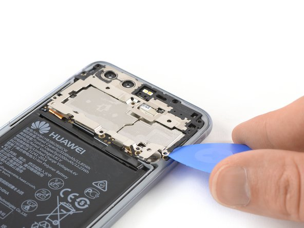 Slide an opening pick under the right side of the motherboard shield.