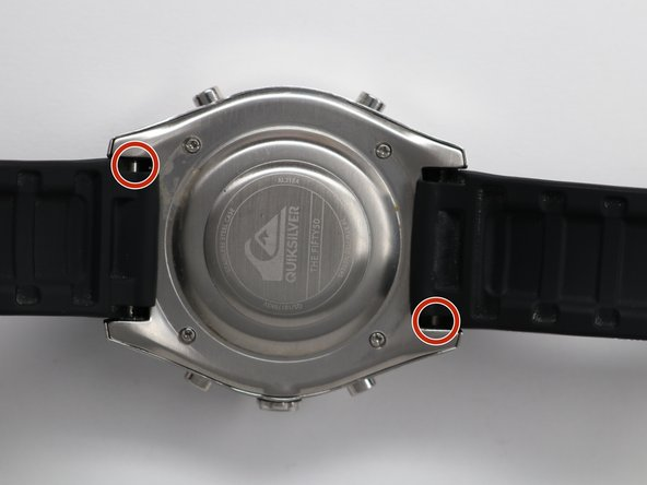 Place the watch (face down) on a solid surface.