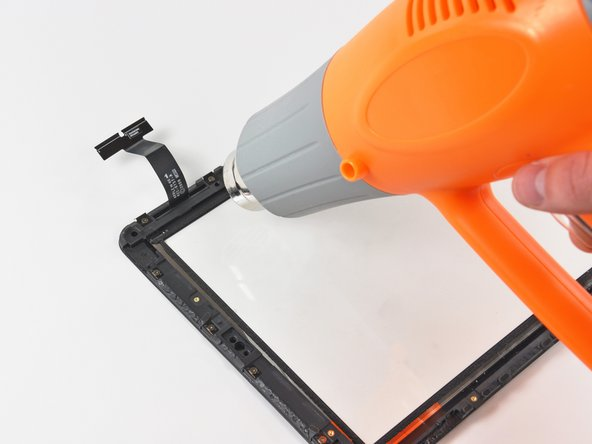 In this step, you will heat and remove the plastic frame near the digitizer cable. Do not directly heat this ribbon cable, as it is extremely thin and sensitive to heat.