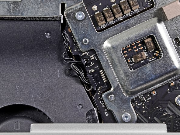Pull the CPU fan/ambient temperature sensor connector toward the bottom left edge of the iMac and out of its socket on the logic board.