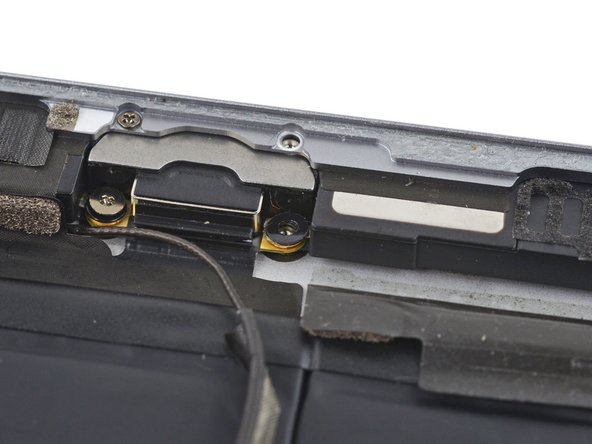 The screw through the Lightning connector has a small washer resting on the speaker contacts. Be sure not to misplace it.