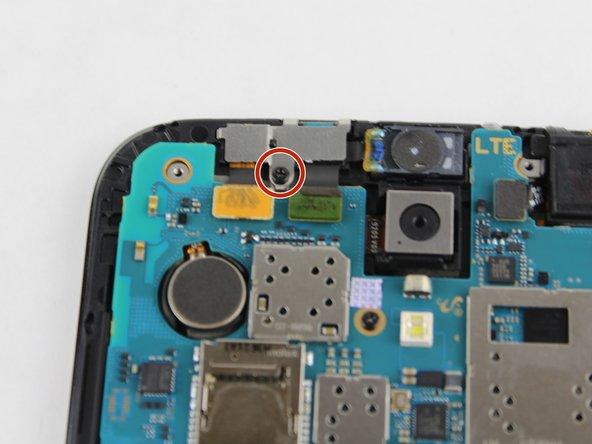 Remove the black 2.55 mm Phillips #000 screw.