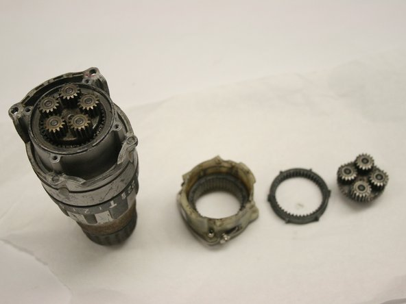 Remove each component from the gear assembly. Replace components as needed.