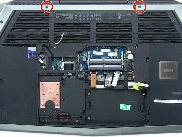 Remove the two 2.5mm x 18mm screws from the top of the laptop.