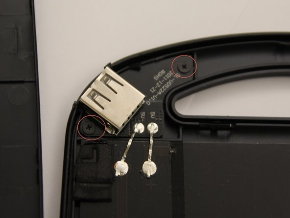 You must now unscrew the circuit board that holds the USB port in place.