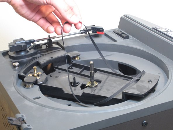 Check the belt to see if it is off the motor or turntable. If the belt is damaged (tearing or lack of smoothness) replace the belt with a new one. If it is off track, realign accordingly.