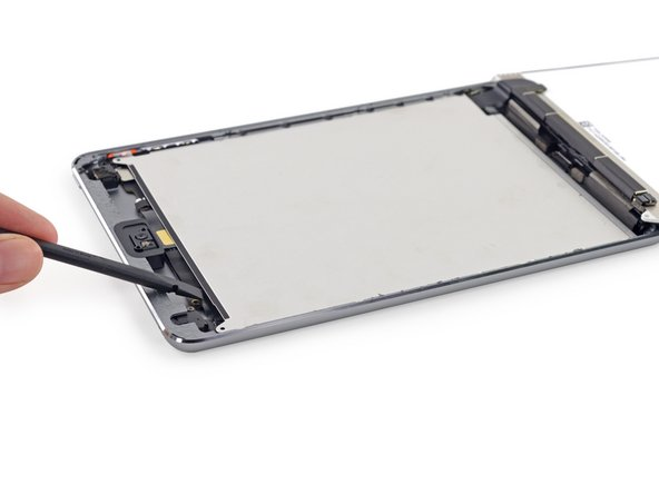 Use the flat end of a spudger to pry the LCD shield plate up and out of the iPad.