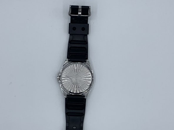 Place the watch upside down.