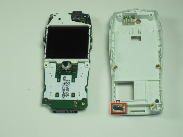 The microphone at the bottom of the rear housing can be levered out using a small screwdriver or any similar tool.