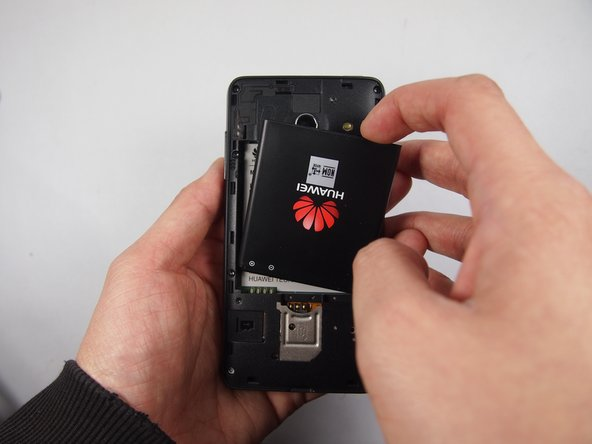 Lift the battery with your finger up and out to remove the battery for replacement.