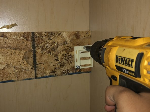 Start removing the mounts and tracks by unscrewing them with your drill or screwdriver.
