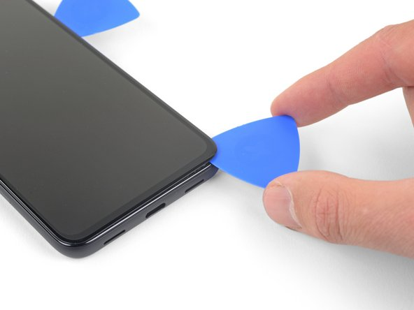 The screen adhesive is very weak and you should not need to re-apply heat. If the screen does feel hard to slice, apply heat to the difficult area for one minute and try again.