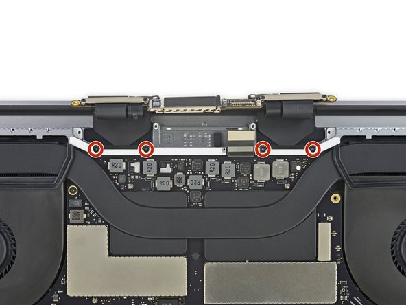 Use a T3 Torx driver to remove the four 3.9 mm screws securing the display cable cover springs.
