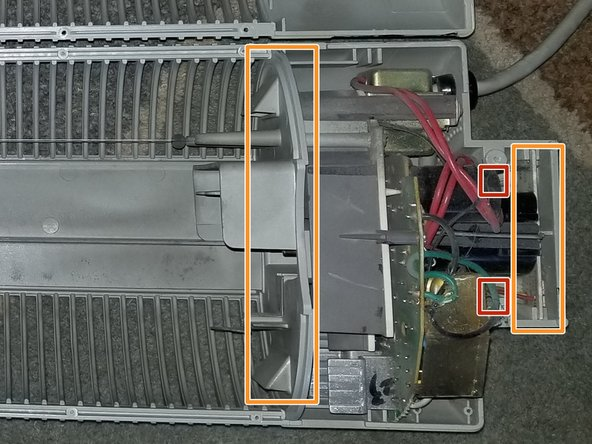 If you look at the smaller bottom PCB you will notice 2 wires on both sides of it. Slightly above that there should be some hot glue holding these wires to the plastic housing. You cannot see it in the picture but its estimated location is highlighted in red. Remove this and any hot glue that's holding the main power cable in place.
