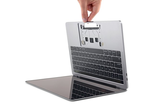 The liquid adhesive remover provided in your kit can cause damage if it contacts the MacBook Pro's display or keyboard.
