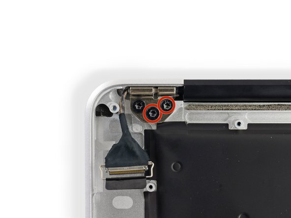 Remove the inner two 5.6 mm T8 Torx screws securing the right display hinge to the upper case.