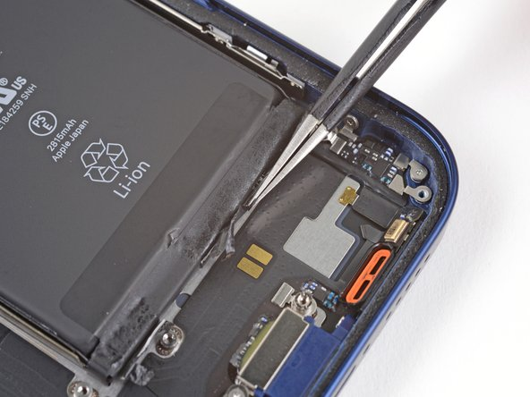 Peel down the second battery adhesive pull-tab to un-stick it from the bottom edge of the battery.