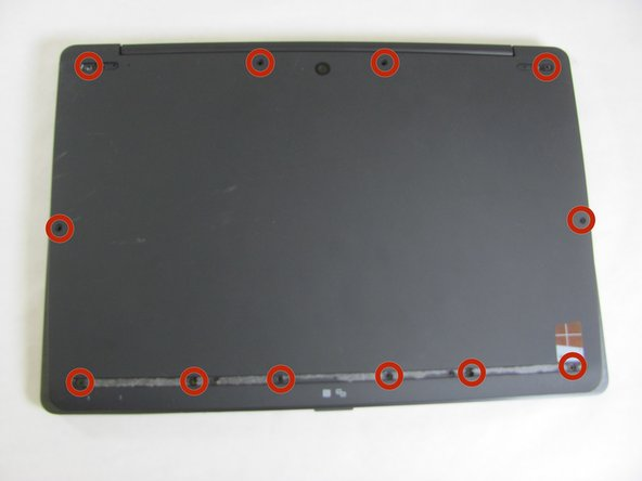 Starting with the laptop top-down, locate and remove the twelve 1mm Phillips #0 screws securing the back cover to the main body of the computer.