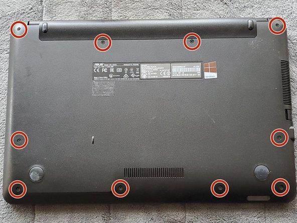 Flip the laptop onto its backside.