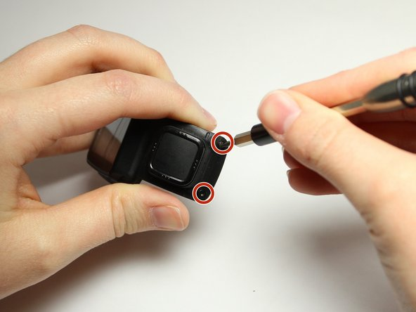 Remove the two 3.0 mm Torx screws from the front.  Use a T4 Torx screwdriver to remove the screws.