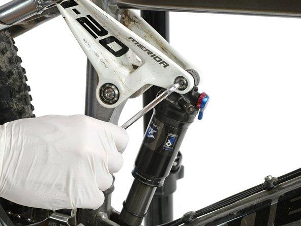 Open the upper damper bolt using a 6mm allen key.
