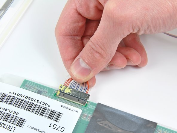 Disconnect the display data cable from the LCD.
