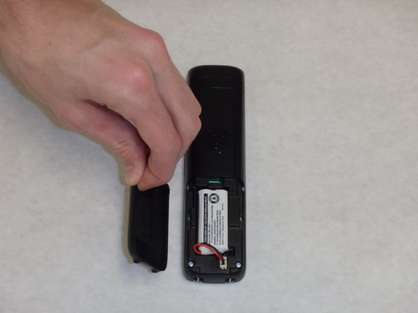 Pull the battery cover off of the back of the phone.