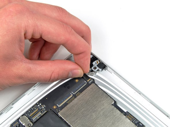Carefully pull the headphone jack cable out of its socket on the logic board.
