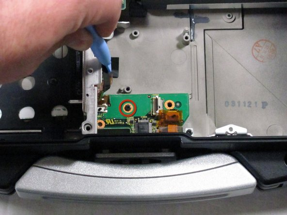 Remove the screw that was previously concealed under the now removed ribbon cable.
