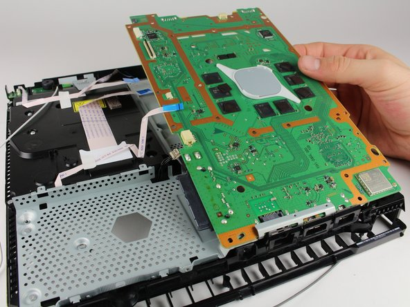 Remove the motherboard by grabbing the edge of the board with one or two hands and pulling away and up.