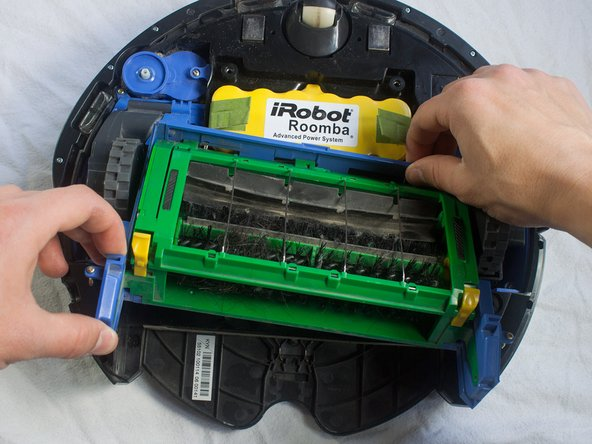 Grab the brush case and pull upwards to remove.