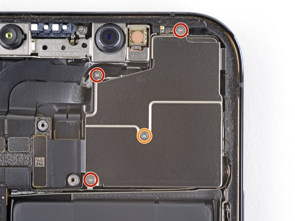 Use a Y000 driver to remove the four screws securing the rear-facing camera sensor.