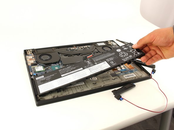 Lift the battery out of the frame and remove it from the device.