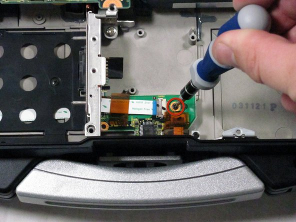 Locate the track pad chip near the handle.