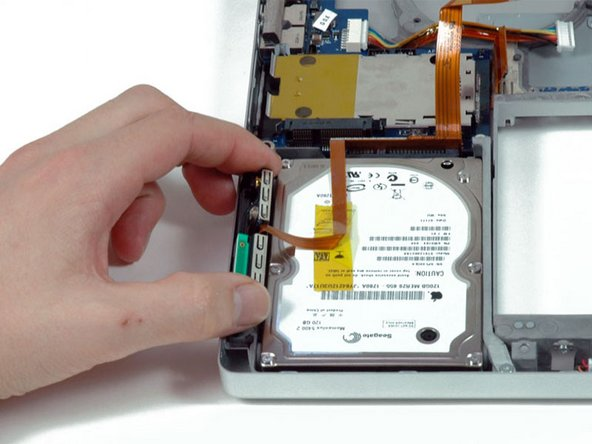 Lift the Bluetooth assembly out of its slot on the left side of the hard drive.