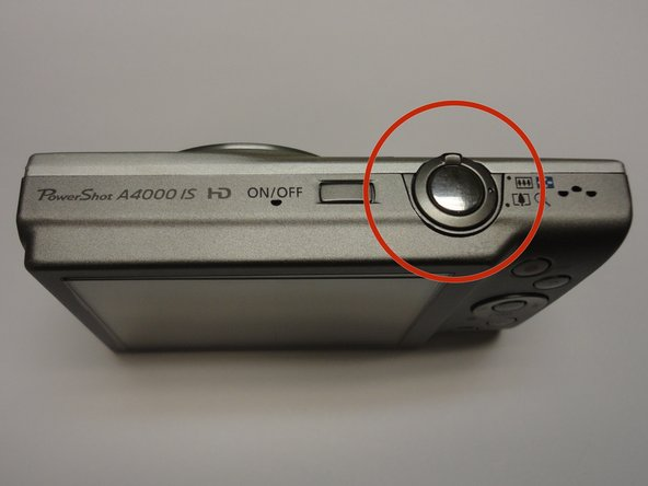 The shutter button is highlighted in red. To focus your camera, press this button down halfway.