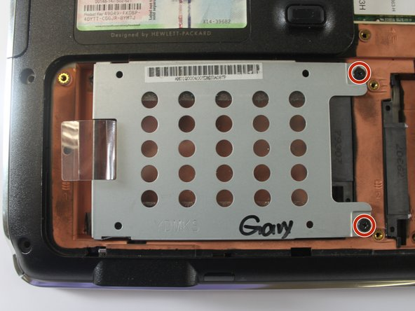 Remove the grey mounting bracket by unscrewing the two Phillips PM2.5×3.0 screws with a Phillips #00 screwdriver.