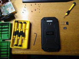 OUKITEL K10000 MAX Stuck SIM Card Removal