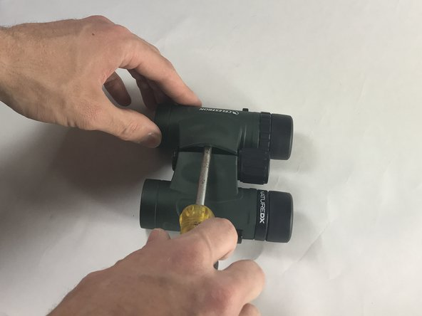 Using a plastic opening tool, nylon spudger or metal spudger, pry into seam of the skin cover at the center of the device. Lightly lift the tool which should cause the skin cover to rise.