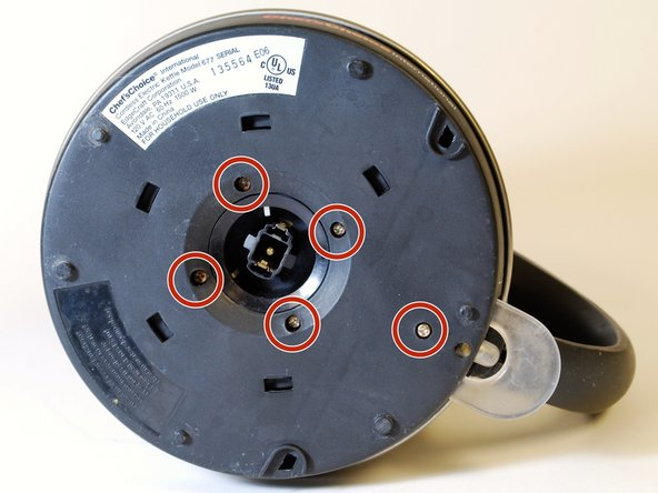 "Remove the five 3/8"" screws from the base of the kettle using a Phillips #1 screwdriver."
