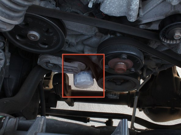 Move the drain pan toward the front of the vehicle. Be careful not to spill any oil!