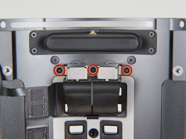 Remove the three 3.7 mm T4 screws securing the audio jacks to the IO panel.