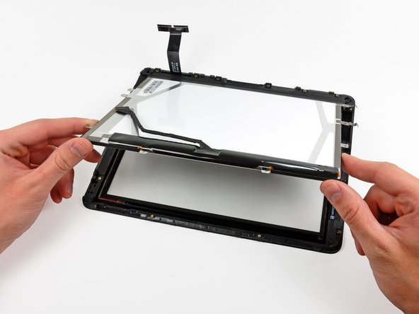 Lift the LCD from its free end, and remove it from the display frame.