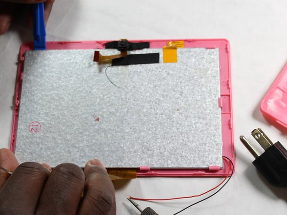 Separate the front screen protector from the lcd screen. There are clamps holding the screen in place.