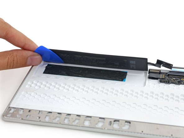 Without those peel-out adhesive strips, more vigorous prying and picking are required to free the battery.