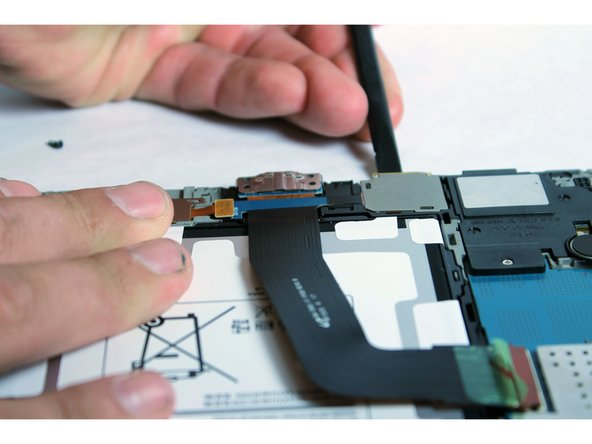 Using the spudger, pry out the SD card slot.