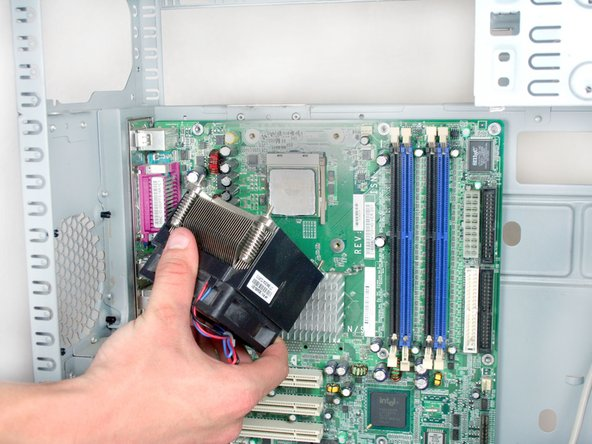 Remove the cpu cooler by pulling out towards the side of the device.